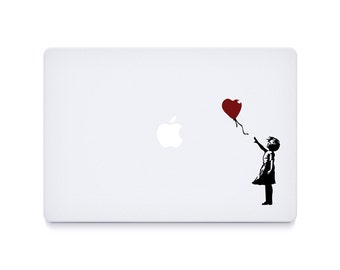 "2x Banksy ""Flower girl"" laptop graphics"