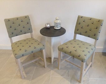 Pair of upholstered chairs in a sage pheasant fabric