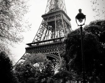 reading paper, Eiffel Tower, Paris 1999.