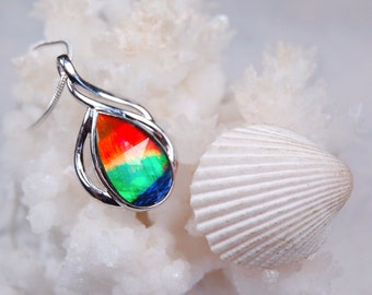 Exquisite four colour grade AA ammolite pendant in sterling silver.