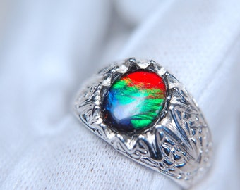 Grade AA Canadian ammolite ring for men in solid heavy sterling silver.