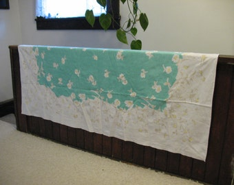 """Vintage cotton tablecloth.  Turquoise center with brown/yellow daisies. 60 x 47"""""""