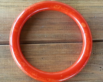 Vintage Bakelite Bangle Red Orange Swirl rounded tubular vintage plastic bangle old costume jewelry