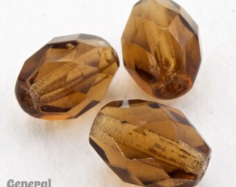 9mm Transparent Smoked Topaz Faceted Oval Bead (25 Pcs)  #4598