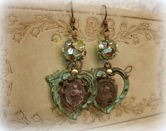vaya con dios one of a kind vintage assemblage earrings . very vintage holy medals swarovski rhinestones patina'd hearts