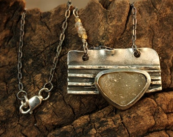 Druzy pendant necklace with folded silver backing in heavily oxidized silver and silver chain