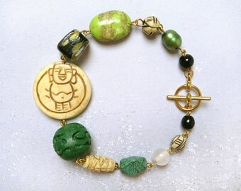 Happy Buddha #2 bracelet - gold plated metal and mixed carved bone, green cinnabar, black yellow glass, pearl, lime magnesite bead bracelet