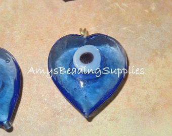 4 Blue Evil Eye Heart Pendants with silver pinning