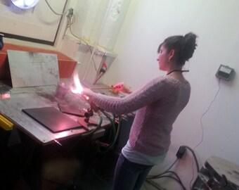 One spot in a glassblowing/lampworking make-a-pendant workshop in Philadelphia