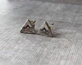 Teeny triangle sterling silver earrings. Handmade artisan jewellery made with recycled silver.