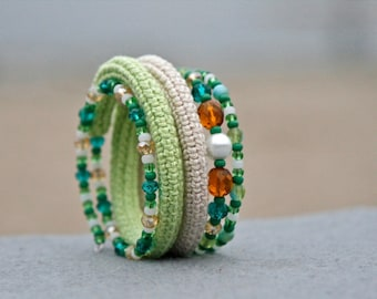 crochet wrap bracelet with glass beads in light green and natural white
