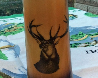 Vintage vase with deer on translucent glass