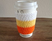 Crochet cup cozy, , reusable coffee sleeve, coffee cup cozy in candy corn colors, orange, yellow and white. Halloween coffee cup cozy.