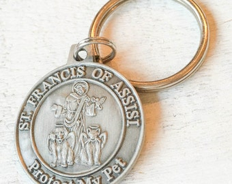 Our dog tags make a unique personalized gift. Each tag is crafted in our Bozeman, Montana studio by dog lovers. St Francis of Assisi Pet Tag