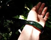 Vintage genuine nephrite jade jadeite bangle bracelet in dark moss green color. Gemstone bangle, ethnic jewelry, statement bracelet