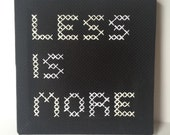 Hand embroidered sign // Less Is More // cross stitched sign // minimalist decor // Black and White // embroidered quote