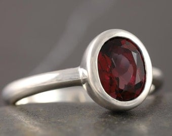 Garnet solitaire engagement ring in sterling silver ring