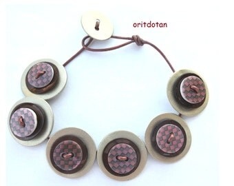Button bracelet jewelry made of vintage shell buttons and new shell buttons beaded on leather cord