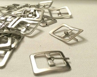 "24 Small silver tone buckles for a 5/8"" strap"