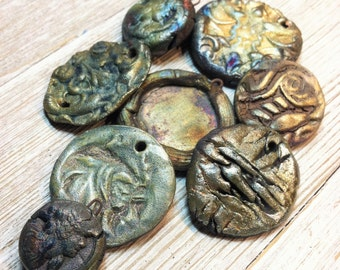 Raku Bits and Pieces Eight Pendants Gold, Magenta Blue Silver Rust Green