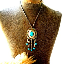 Runway vintage 70s silvertone metal boho  necklace  with oversize pendant accented with a faux turquoise.