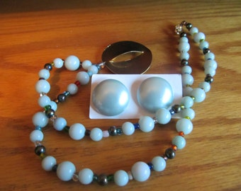 white and varied colored bead necklace plus