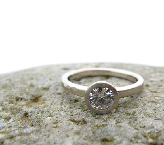 Simple Solitaire bezel set engagement ring 14kt palladium white gold and forever one moissanite