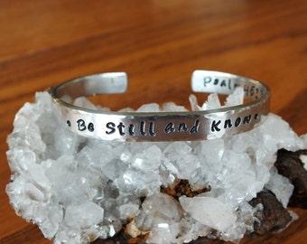 "Be Still and Know - 1/4"" Aluminum Prayer Cuff"