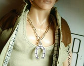 Silver Horseshoe Charm Pendant Necklace on Silver Chain.