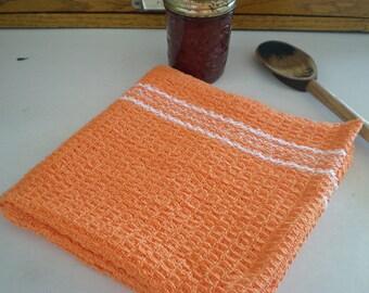 Handwoven waffleweave kitchen towel in orange and white
