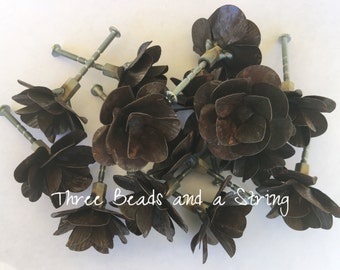 2 Rusty Metal Flower Knobs