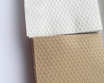 Set of 40 white polka dot embossed napkins for your bridal shower or party.  Bevrrage size  Square.