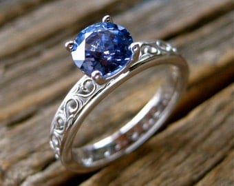 Light Blue Sapphire Engagement Ring in 18K White Gold with Floral Scroll Pattern Size 5