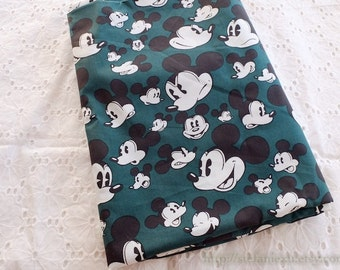 Cartoon Character Collection, Lovely Retro Black Mickey Mouse Head On Dark Green - Silk Cotton Fabric (1/2 Yard)