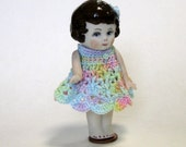 Handcrafted Frozen Charlotte 3 inch wearing rainbow crocheted dress