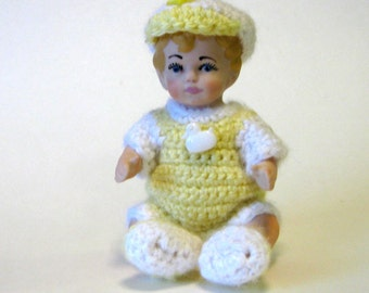 "handcrafted 5"" porcelain doll dressed in yellow"