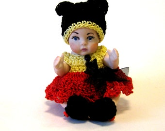"""Hancrafted porcelain 5"""" baby girl in knitted mouse clothing"""