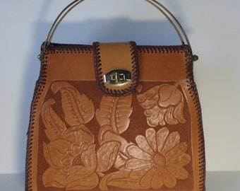 Gorgeous Vintage Tooled Leather Handbag with Gold tone Metal Handles.