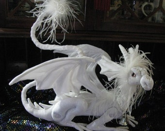 This is Ice-Wynd, a Snow dragon by Dragontry