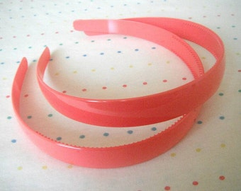 "Wide Coral Pair of Plastic Headbands, 3/4"" Wide"
