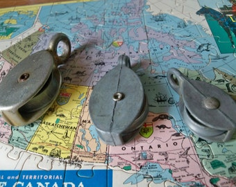 vintage mama papa and baby galvanized pulleys