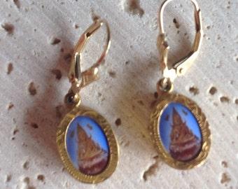 Gold, blue Thai amulet earrings.