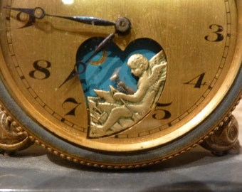 Le Petit Forgeron Antique Mechanical Animated Desk Clock. Tiny Winged Angel Hammers the Seconds. Circa 1900. Brass French or Swiss Made