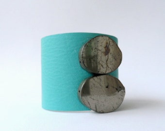 "leather cuff bracelet  - turquoise leather with two oval pyrite pieces  - 2"" wide"