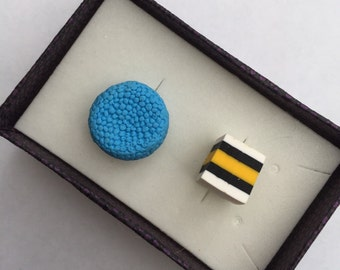 Funky pair of white black and yellow cube and blue round liquorice allsorts polymer clay cufflinks
