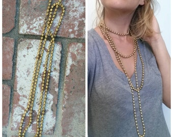 Long chain of Golden metal Beads