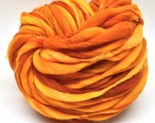 Thick and thin super bulky yarn in hand dyed merino wool - 56 yards and 3.75 ounces/ 107 grams