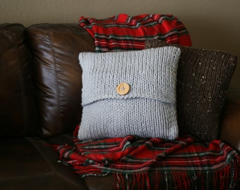 Super-chunky knit pillowcase with wood button in gray