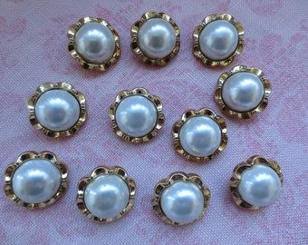 Vintage faux pearl white center gold tone scalloped edge design plastic shank button. Lot of 11 buttons..