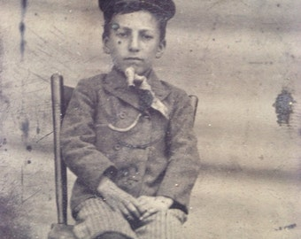 Daguerreotype of Boy Wearing Hat And Knickers Sitting On Chair Sepia Tintype Photo From 1800s Little Boy Photo